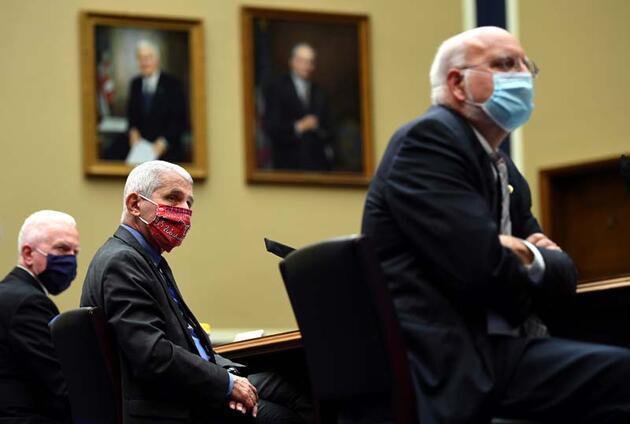 ABD'nin virüsle savaşındaki baş isim! Trump ve Biden'a aşı çağrısı